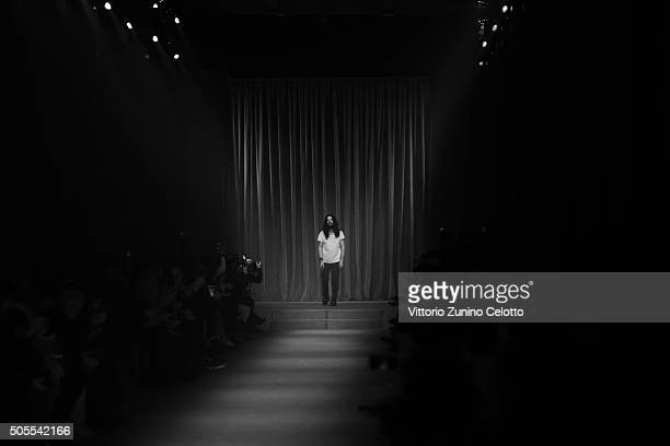 Designer Alessandro Michele walks the runway at the Gucci show during Milan Men's Fashion Week Fall/Winter 2016/17 on January 18 2016 in Milan Italy