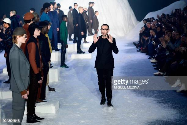 Designer Alessandro Sartori greets the audience at the end of the show for fashion house Ermenegildo Zegna during the Men's Fall/Winter 2019 fashion...