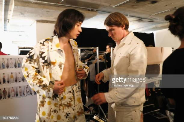 Designer Alex Mullins and a model are seen backstage ahead of the Alex Mullins show during the London Fashion Week Men's June 2017 collections on...