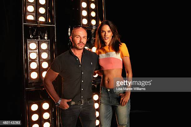 Designer Alex Perry poses with model Alessandra Ambrosio backstage ahead of the Alex Perry show at MercedesBenz Fashion Week Australia 2014 at...