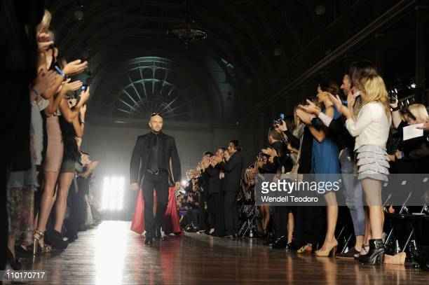 Designer Alex Perry walks the catwlak as part of the LMFF Red Carpet runway show on day three of the 2011 L'Oreal Melbourne Fashion Festival at The...