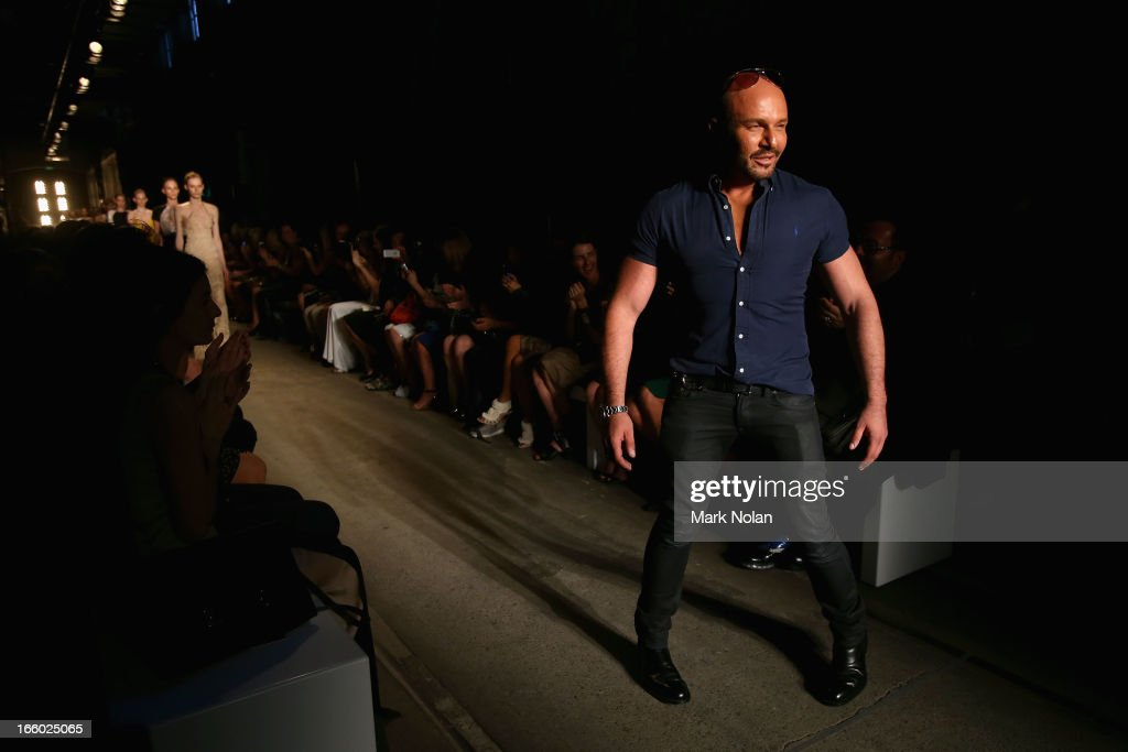Designer Alex Perry walks the runway after the Alex Perry show during Mercedes-Benz Fashion Week Australia Spring/Summer 2013/14 at Carriageworks on April 8, 2013 in Sydney, Australia.