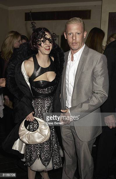 Designer Alexander McQueen and Isabella Blow attend the Tatler dinner at Floriana at the Beauchamp place on March 19 2003