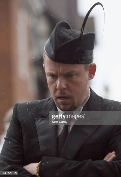 Designer Alexander McQueen arrives for the funeral service for fashion stylist Isabella Blow at Gloucester Cathedral on May 15 2007 in Gloucester...