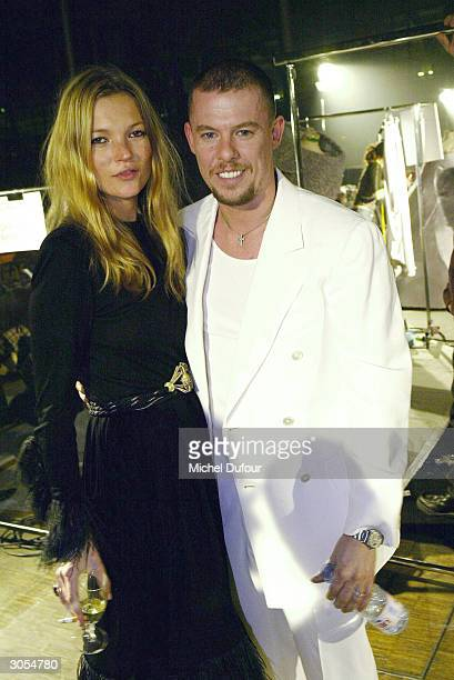 Designer Alexander McQueen poses with model Kate Moss at the Alexander McQueen readytowear FallWinter collection 20042005 fashion show on March 5...