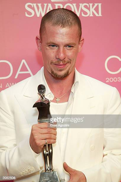 """Designer Alexander McQueen, winner of the """"International Award"""" poses backstage at the """"2003 CFDA Fashion Awards"""" at the New York Public Library on..."""