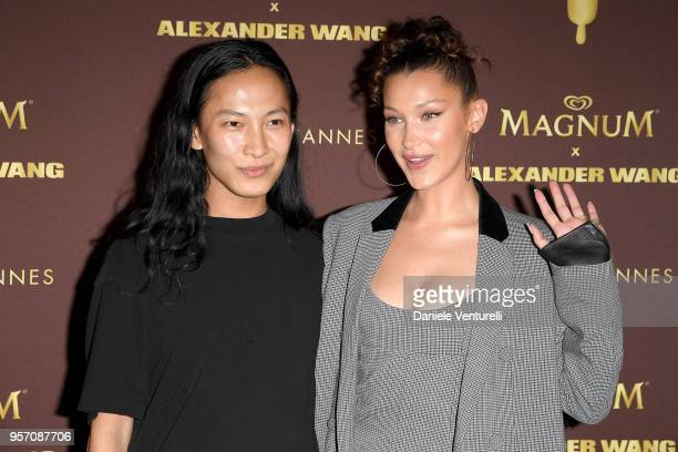 Designer Alexander Wang and model Bella Hadid attend the Magnum VIP party during the 71st annual Cannes Film Festival at Magnum Beach on May 10 2018...