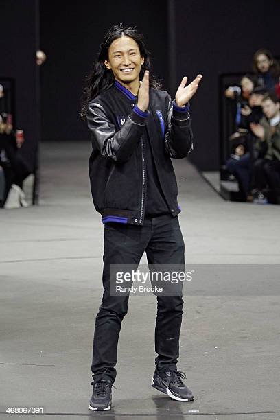 Designer Alexander Wang applauds the audience at the end of the Alexander Wang during MercedesBenz Fashion Week Fall 2014 at the Duggal Greenhouse on...