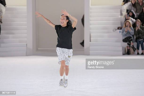 Designer Alexander Wang greets the audience after his Alexander Wang Resort Runway show June 2018 New York Fashion Week on June 3 2018 in New York...