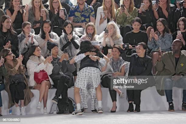 Designer Alexander Wang hugs an audience member after his Alexander Wang Resort Runway show June 2018 New York Fashion Week on June 3 2018 in New...