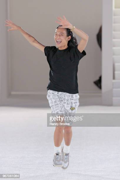 Designer Alexander Wang runs jumps and waves to the audience after his Alexander Wang Resort Runway show June 2018 New York Fashion Week on June 3...