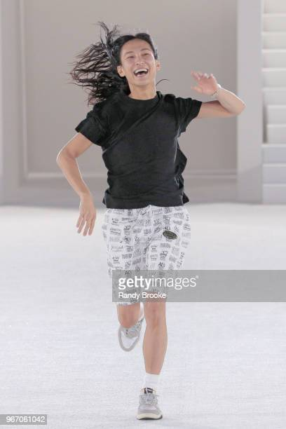 Designer Alexander Wang runs out on the runway to greet the audience after his Alexander Wang Resort Runway show June 2018 New York Fashion Week on...