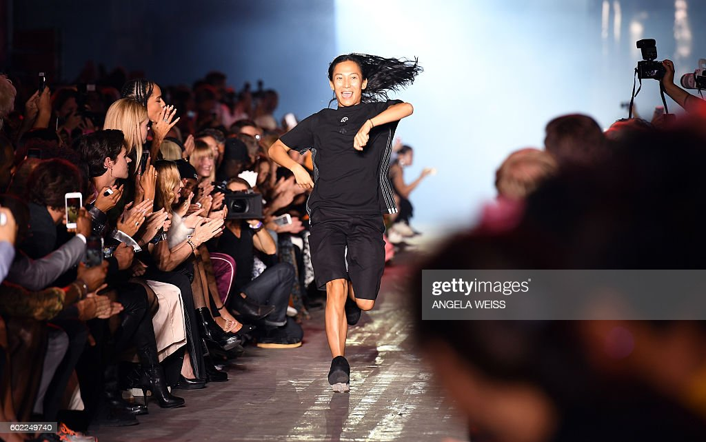Designer Alexander Wang walks the runway during his show at New York Fashion Week in New York on September 10, 2016. / AFP / ANGELA