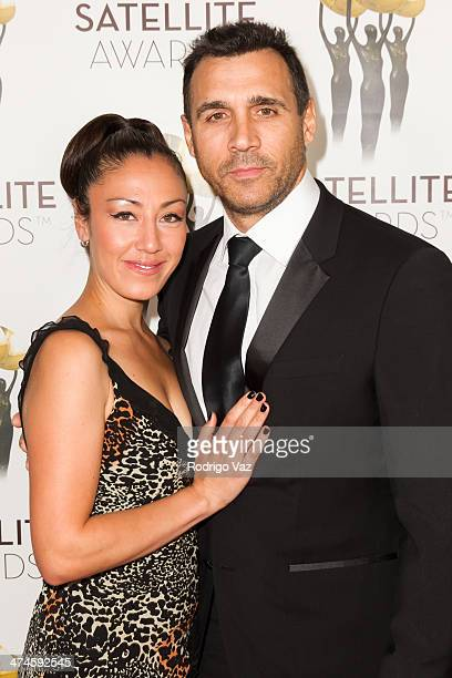 Designer Alexandra Tonelli and actor Adrian Paul arrive at the International Press Academy Satellite Awards at InterContinental Hotel on February 23,...