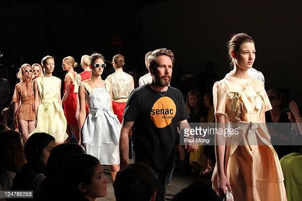 Designer Alexandre Herchcovitch walks the runway during the finale of the Alexandre Herchcovitch Spring 2012 fashion show during Mercedes-Benz...