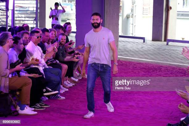 Designer Alexandre Mattiussi salutes the guests at the end of the the Ami show during the Paris Fashion Week Menswear Spring/Summer 2018 on June 22...