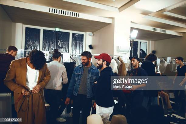 Designer Alexandre Mattiussi seen with models backstage before the Ami Alexandre Mattiussi Menswear Fall/Winter 20192020 show at Palais de Chaillot...