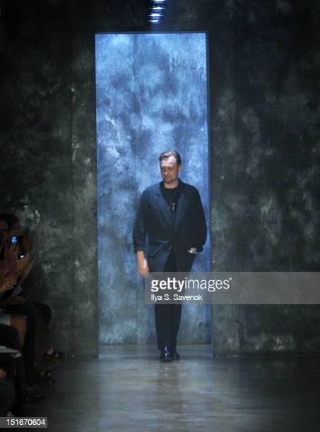 Designer Alexandre Plokhov walks the runway during the Alexandre Plokhov show during Spring 2013 Mercedes-Benz Fashion Week at Milk Studios on...