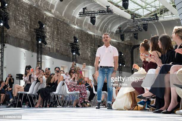 Designer Alexandre Vauthier acknowledges the applause of the public after the Alexandre Vauthier Haute Couture Fall/Winter 2019 2020 show as part of...