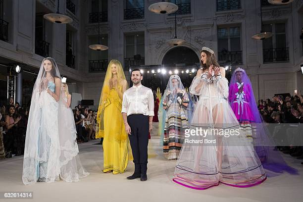 Designer Alexis Mabille pose with models after the Alexis Mabille Spring Summer 2017 show as part of Paris Fashion Week on January 24, 2017 in Paris,...