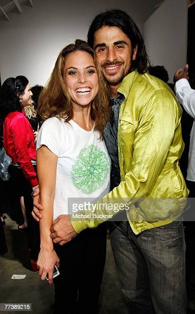 Designer Ali Alborzi and wife Josie Maran backstage at the Evidence Of Evolution Spring 2008 fashion show during MercedesBenz Fashion Week held at...