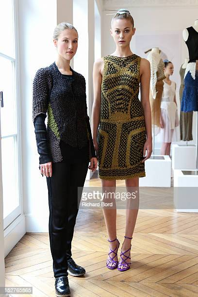 Designer Alice Lemoine poses with a model during the Le Moine Tricote Spring / Summer 2013 show as part of Paris Fashion Week on September 25 2012 in...
