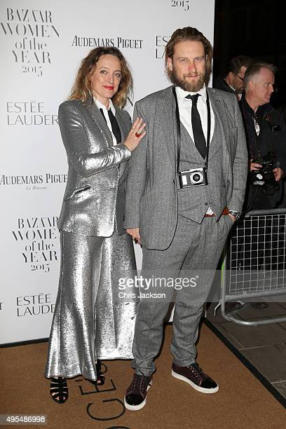 Designer Alice Temperley and Greg Williams attend Harper's Bazaar Women of the Year Awards at Claridge's Hotel on November 3 2015 in London England
