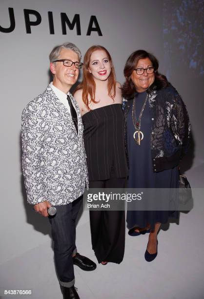 Designer Alyssa Wardrop Fashion Institute of Technology poses with Buxton Midyette and Fern Mallis at Supima Design Competition SS18 runway show...