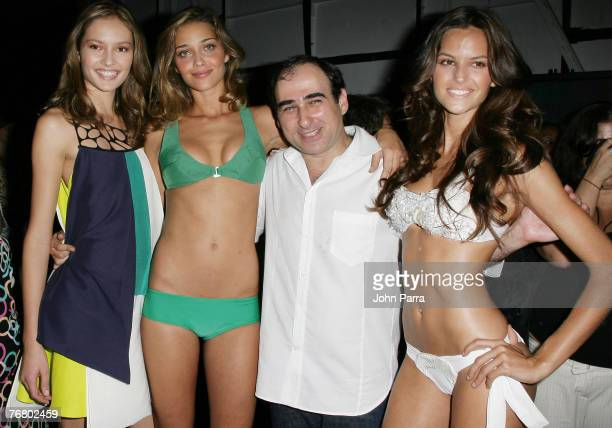 Designer Amir Slama with models backstage at the Rosa Cha 2008 Fashion Show at the Tent in Bryant Park during the MercedesBenz Fashion Week Spring...
