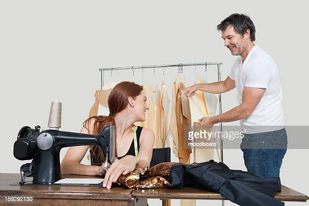 designer and coworker working in design studio - polyester stock photos and pictures