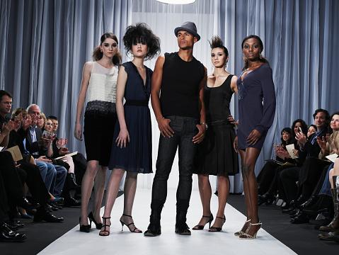 Designer and female models standing on catwalk - gettyimageskorea