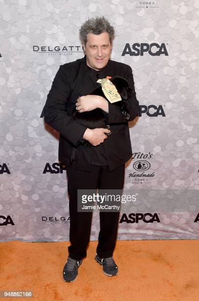 Designer and host Isaac Mizrahi poses with a puppy during the 21st Annual Bergh Ball hosted by the ASPCA at The Plaza Hotel on April 19 2018 in New...