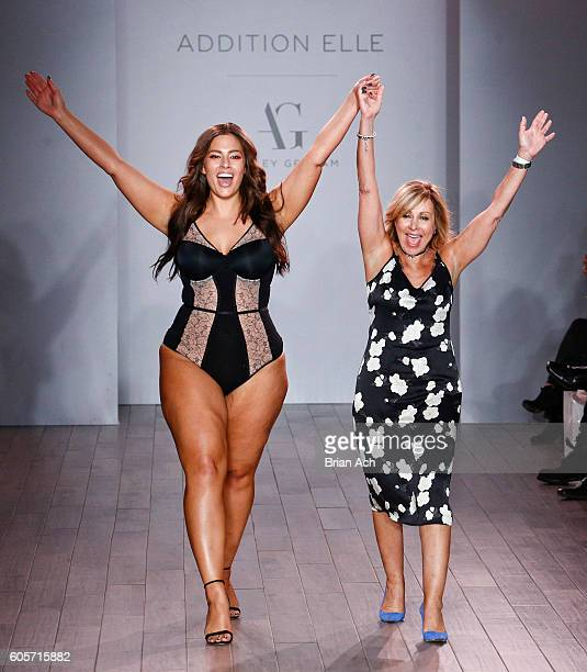 Designer and model Ashley Graham appears on the runway at the Addition Elle Presents Holiday 2016 RTW + Ashley Graham Lingerie fashion show during...