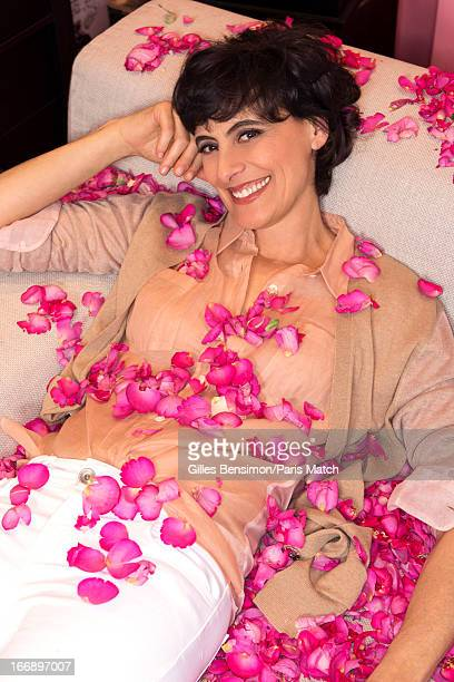 Designer and model Ines de la Fressange is photographed in her office at Roger Vivier for Paris Match on May 4 2012 in Paris France