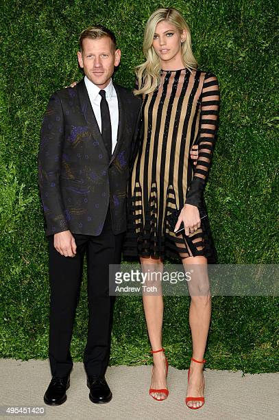 Designer and previous winner Paul Andrew and model Devon Windsor attend the 12th annual CFDA/Vogue Fashion Fund Awards at Spring Studios on November...