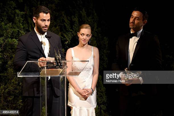 Designer and winner Jonathan Simkhai accepts an award onstage with Actress Amanda Seyfried and designer and keynote speaker Riccardo Tisci at the...