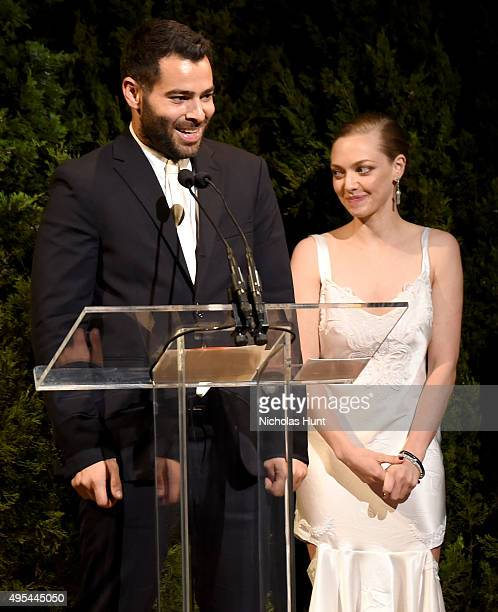 Designer and winner Jonathan Simkhai accepts an award onstage with Actress Amanda Seyfried at the 12th annual CFDA/Vogue Fashion Fund Awards at...