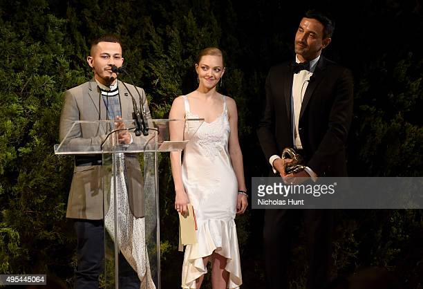 Designer and winner Rio Uribe accepts an award onstage with Actress Amanda Seyfried and designer and keynote speaker Riccardo Tisci at the 12th...