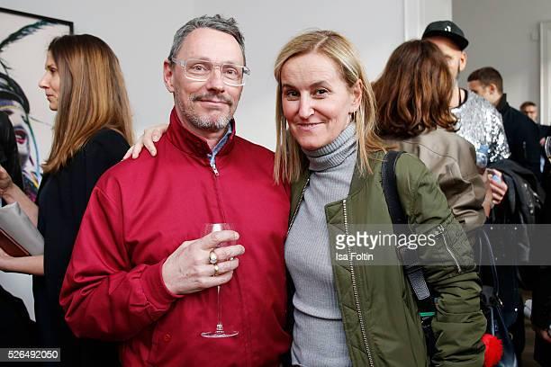 Designer Andre Odier and Petra Fladenhofer at 'Der Berliner Fotografie Salon Edition 1' on April 29 2016 in Berlin Germany