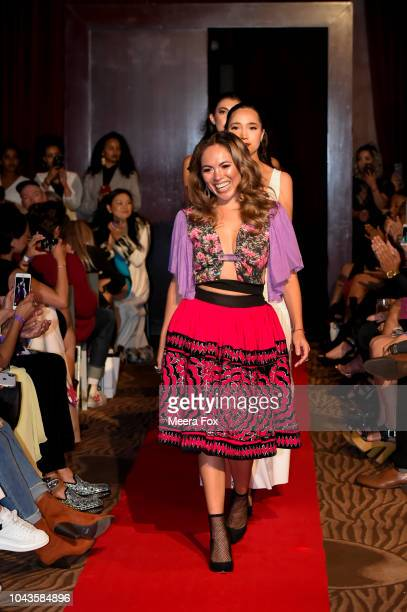 Designer Andrea Alvarado and her models walk the runway for her bow at the 2018 Fashion Community Week PretaPorter Fashion Show wearing her designs...