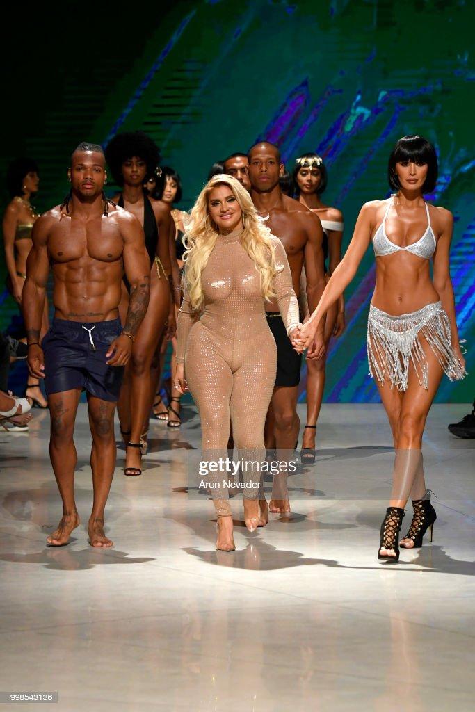 Designer Andrea Gaviria and models walk the runway for OMG