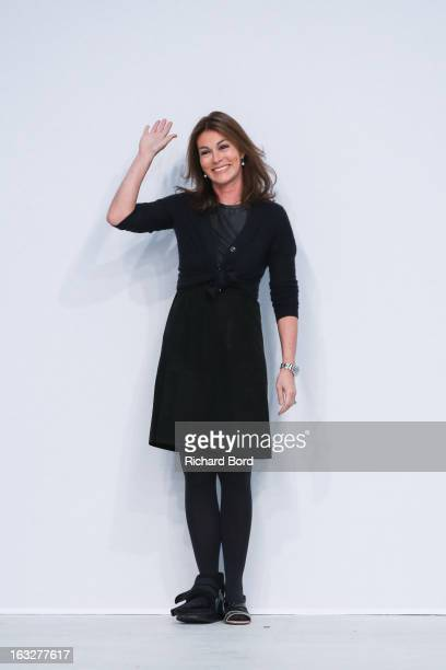 Designer Andrea Karg walks the runway during the Allude Fall/Winter 2013 ReadytoWear show as part of Paris Fashion Week at Palais de Tokyo on March 6...