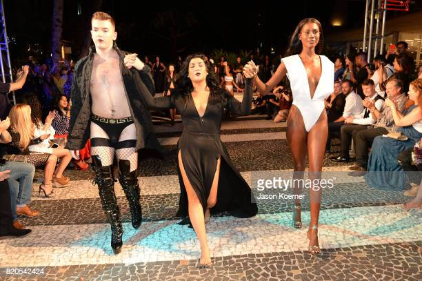 Designer Andrea Tankovitz walks with models at the 'Tankovitz on Lincoln Road' event presented by DIVE Swim Week on July 21 2017 in Miami Florida