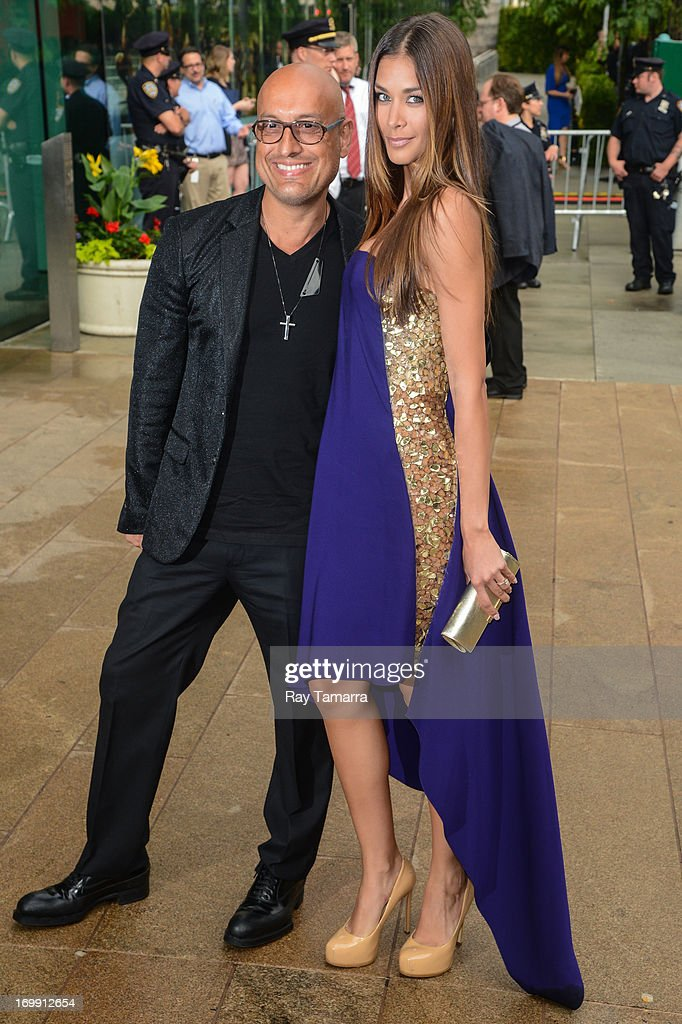 Designer Angel Sanchez (L) and TV personality Dayana Mendoza enter the 2013 CFDA Fashion Awards on June 3, 2013 in New York, United States.
