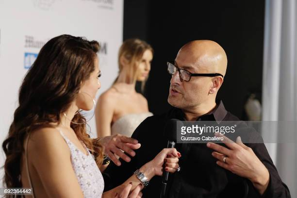 Designer Angel Sanchez answers questions backstage at the Angel Sanchez Show during Miami Fashion Week at Ice Palace Film Studios on June 4 2017 in...