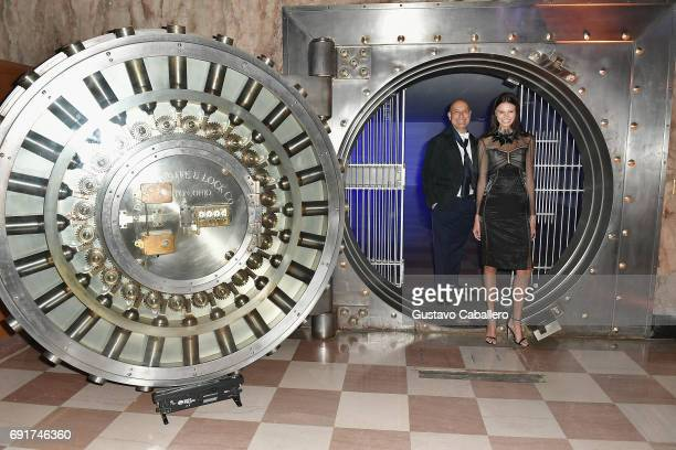 Designer Angel Sanchez poses with a model at the Miami Fashion Week Benefit Gala at Dupont Building on June 2 2017 in Miami Florida