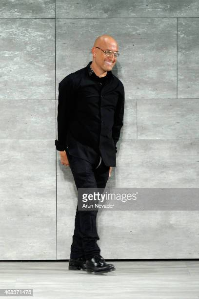 Designer Angel Sanchez walks the runway at the Angel Sanchez fashion show during Mercedes-Benz Fashion Week Fall 2014 at The Pavilion at Lincoln...