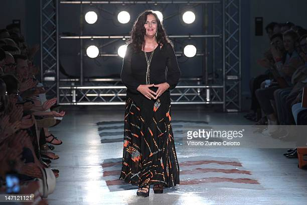 Designer Angela Missoni acknowledges the applause of the audience after the Missoni show as part of Milan Fashion Week Menswear Spring/Summer 2013 on...