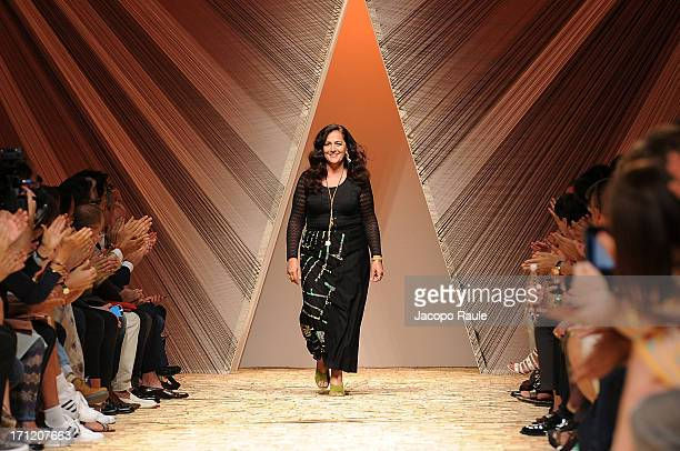 Designer Angela Missoni acknowledges the applause of the audience after the Missoni show during Milan Menswear Fashion Week Spring Summer 2014 on...