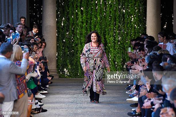 Designer Angela Missoni acknowledges the applause of the audience after the Missoni show during Milan Men's Fashion Week Spring/Summer 2017 on June...